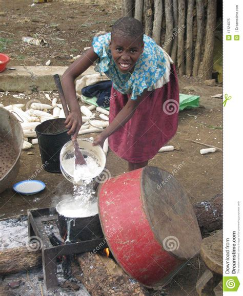 young african rural girl cooking lunch   open