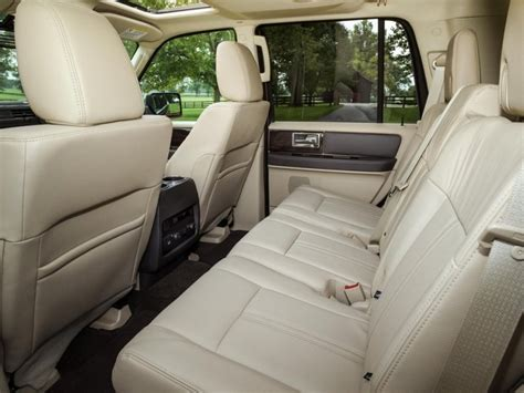 2014 which three row suvs offer second row captain chairs