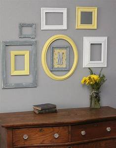 Picture of cream grey and yellow frames on a light wall