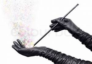 Magician hands in long black gloves holding magic wand and ...