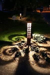 Swirls bollard by driveway eclectic landscape