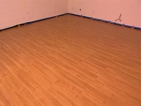 flooring installed how to install snap together laminate flooring hgtv