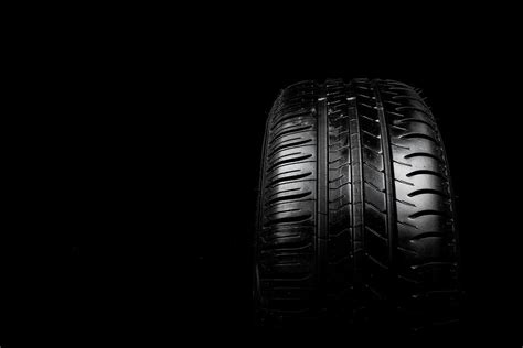 Car Tyre Isolated On A Black Background Photograph By Ben