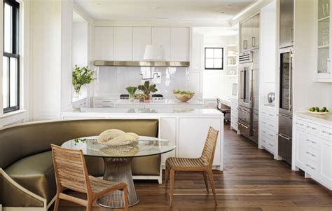 open kitchen in white with diner style curved banquette