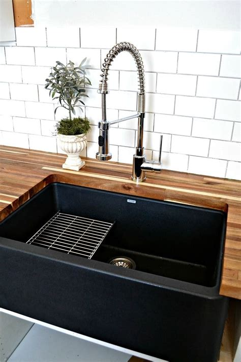 black sinks kitchen a black farmhouse sink gives our country kitchen a warm 1707