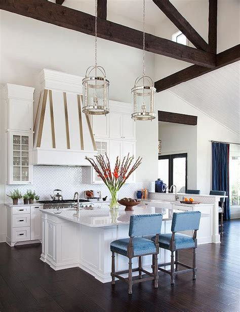 kitchen cabinets tall ceilings kitchen with dark stained truss ceiling and round mirrored