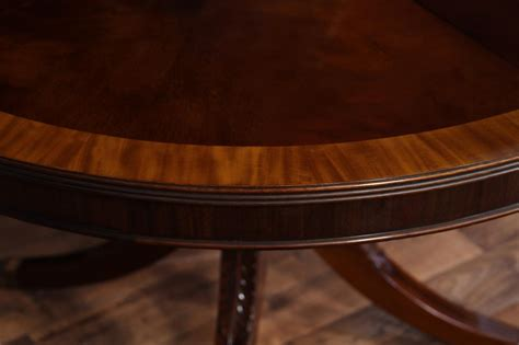 66 inch round table high end mahogany dining table in a walnut finish 48 to 66