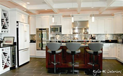 U shaped kitchen with island and raised bar top. Coffered