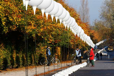 at stands with balloons placed along the former berlin wall location at