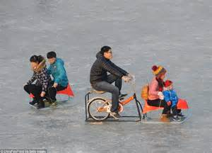 Beijing Boating Lake Freezes Solid So Tourists Take