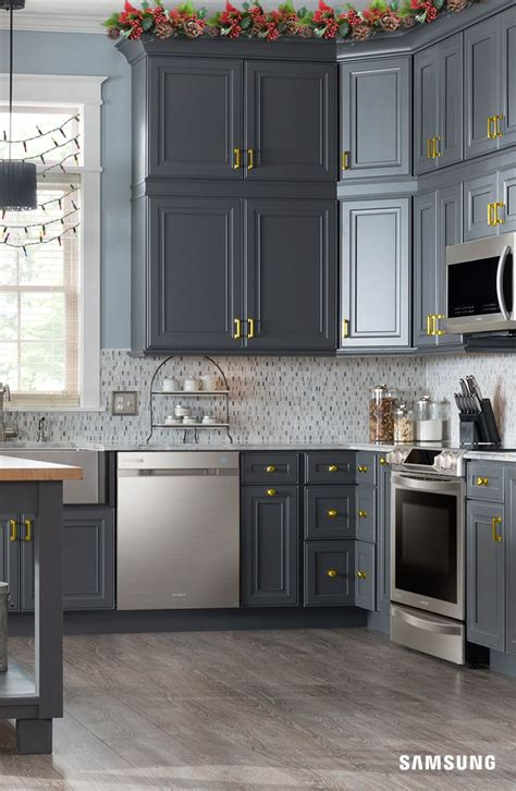 gray kitchen cabinets with stainless steel appliances rustic meets modern in this samsung kitchen our sleek