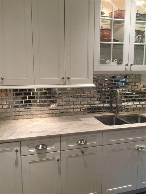 mirrored backsplash in kitchen simply white kitchen cabinet taj mahal quartzite mirrored subway tile kitchen splashbacks