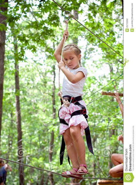 young girl balancing  rope stock photography image