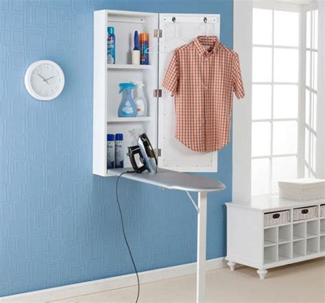 ironing board cabinet with storage cabinetry is not just for the kitchen juz interior