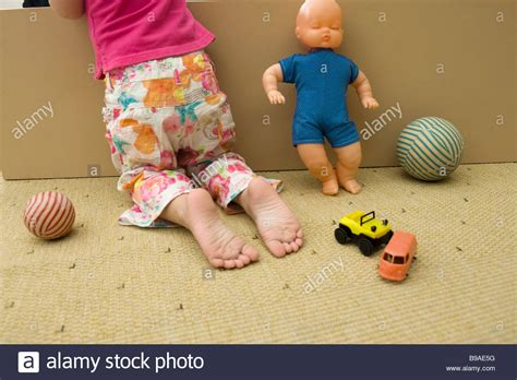 girl kneeling  floor  toys rear view