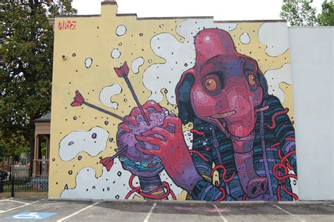 graffiti mural artists a graphic style elephant clutches a hamburger in this