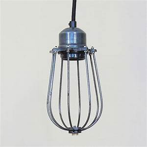 Industrial cage pendant light by the den now
