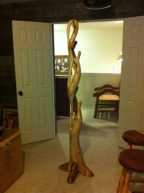 hat and coat rack made of a tree root my rustic