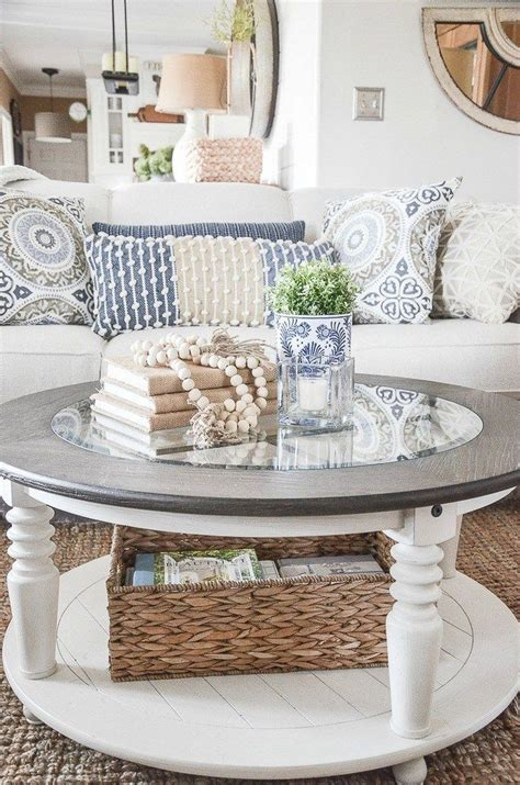 Round coffee table with additional storage space. Popular Farmhouse Coffee Tables Ideas 14 in 2020   Round coffee table decor, Coffee table ...