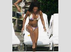 Bikiniclad Mel B swills champagne and chainsmokes on
