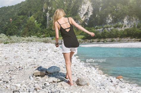 Barefoot Woman Walking Rocks River Stock Photo