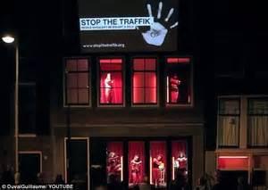 Men cheer on dancing half-naked women in Amsterdam's red ...