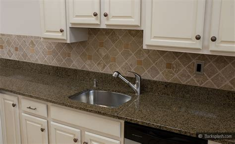 brown cabinets with white countertops tropic brown countertop travertine backsplash tile