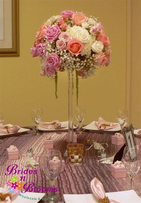 Sprei Eiffel Tower centerpiece with roses spray roses baby s breath