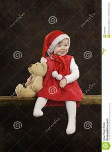 Little Girl With Christmas Hat And Teddy Bear On Black ...
