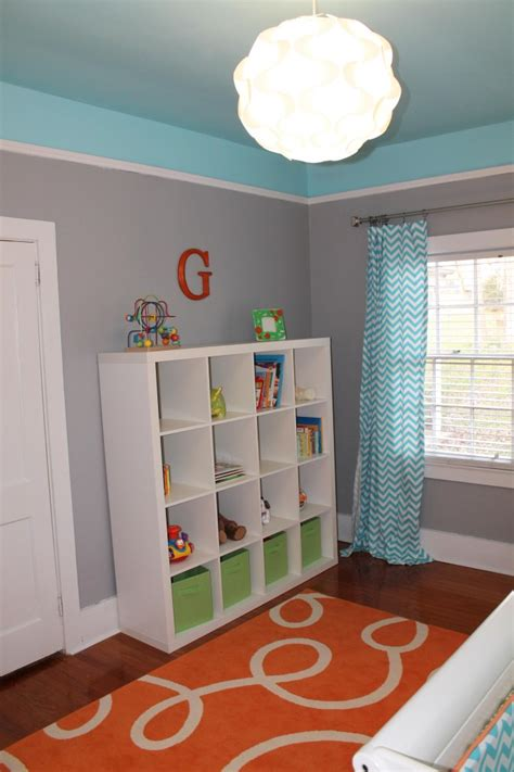 orange grey and turquoise living room gray room with orange accents paint gray is sparrow by