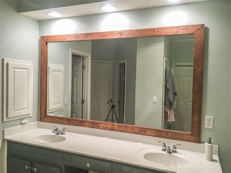 Wood Frame Mirror For Bathroom by How To Diy Upgrade Your Bathroom Mirror With A Stained