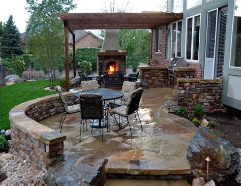patio designs with fireplace exterior breathtaking outdoor patio designs with classic stone fireplace and outdoor kitchen