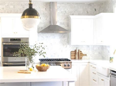 White Kitchen Cabinets with White Subway Tiles