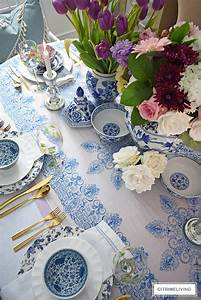 AN EASTER TABLESCAPE WITH BLUE AND WHITE AND LAVENDER