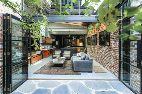 Delicious Interiors With Materials And Gorgeous Outdoor Spaces by This Gorgeous Apartment Used To Be A Commercial Garage