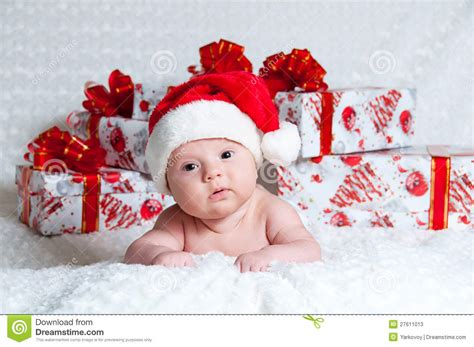 christmas gifts for infant boy newborn baby boy santa claus with gifts stock image image 27611013