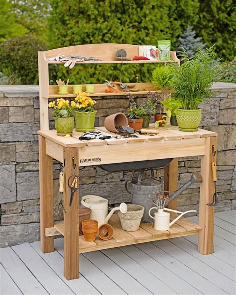 Garden Tables by Potting Bench Cedar Potting Table With Soil Sink And Shelves