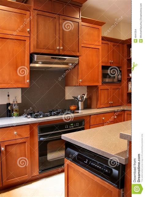 black and wood kitchen cabinets kitchen wood cabinets black and stainless stove stock 7862