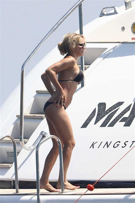 pamela anderson wears  black bikini   yacht