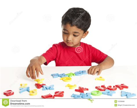 Toddler Learning To Spell With Alphabets Stock Photo