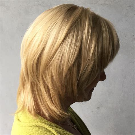 Medium Length Hairstyles For In Their 50s by Best Hairstyles For 50 For 2019 Hair Adviser