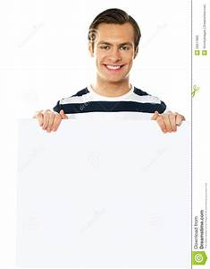 Casual Young Man Holding A Blank Poster Stock Photos ...