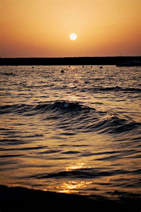 Sunset Stroll Along The Beach Dubai Portrait