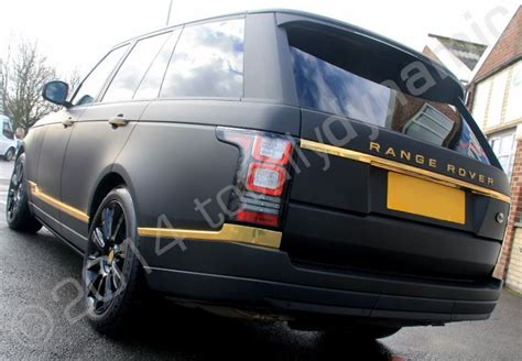 black and gold range rover range rover vogue vinyl wrapped in matt black with mirror