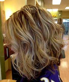 Short Curly Brown Hair with Blonde Highlights