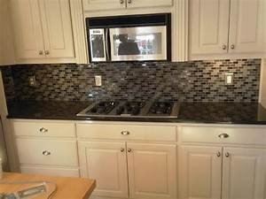 glass tile backsplash especially for a minimalist wall With 2 top design concepts for white tile backsplash
