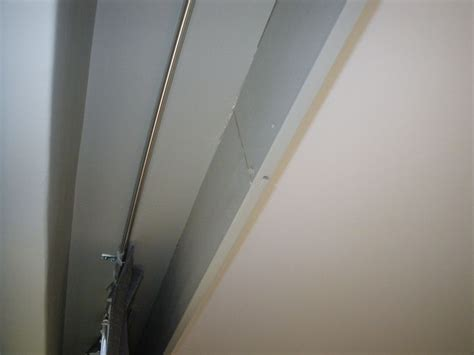 curtains ceiling mounted rail a false bulkhead and