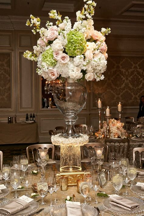reception décor photos wedding centerpiece with pink roses inside weddings