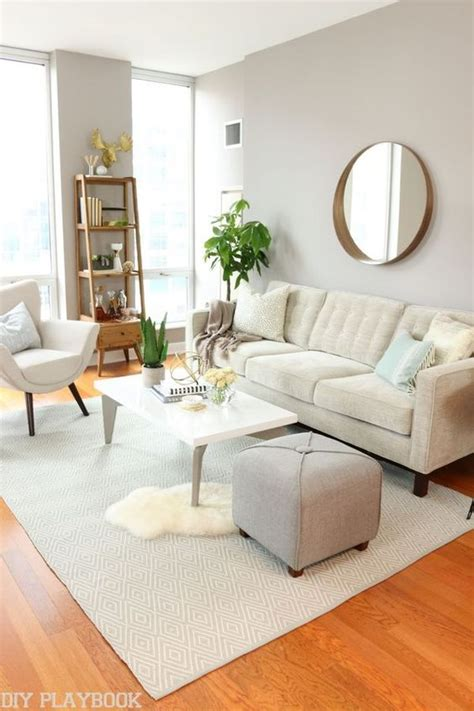 Neutral living rooms City girl and Gold accents on Pinterest