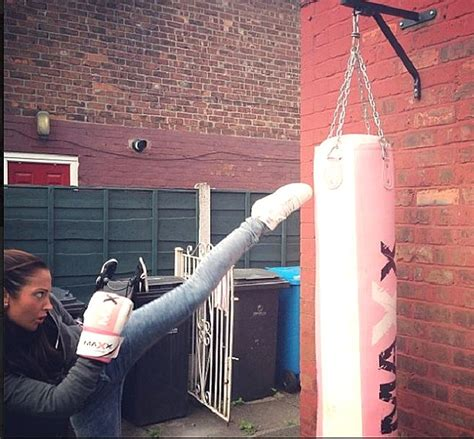 Tulisa pictured looking miserable and posts kickboxing ...